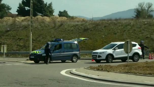 A police vehicle parked on a crossroad in Trebes, near the scene (BFM TV via AP)