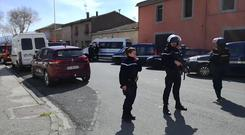 Police attend the incident in Trebes (La Depeche Du Midi via AP)