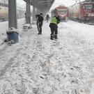 Municipal workers clear ice and snow from the platforms of the Gara de Nord, the main railway station in Bucharest, Romania (Vadim Ghirda/AP)