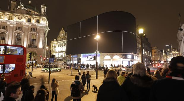 Lights go off for Earth Hour in global call for climate change action