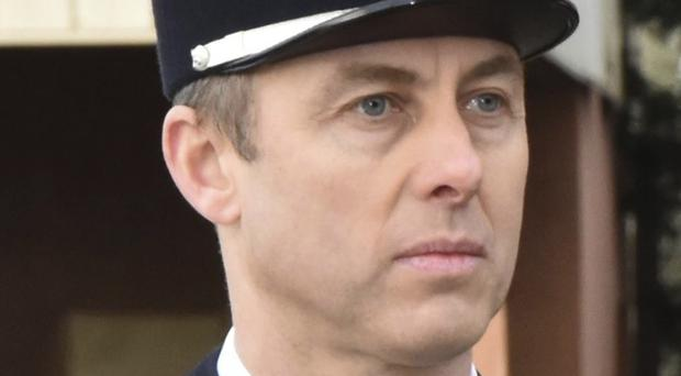 'He fell a hero': France praises policeman who died after hostage swap