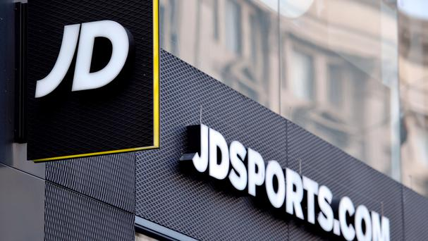 A shop sign for JD Sports in central London (PA)