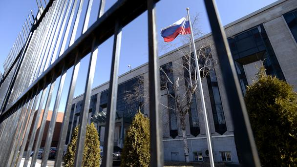 A Russian flag flies outside the Embassy of the Russian Federation to Canada in Ottawa, Ontario (AP)