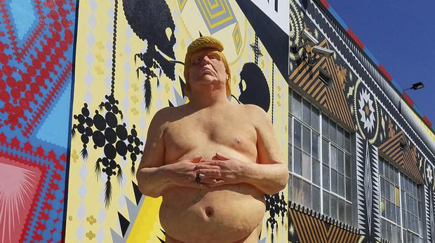 A naked statue of Donald Trump that is going up for auction (Julien's Auctions/AP)