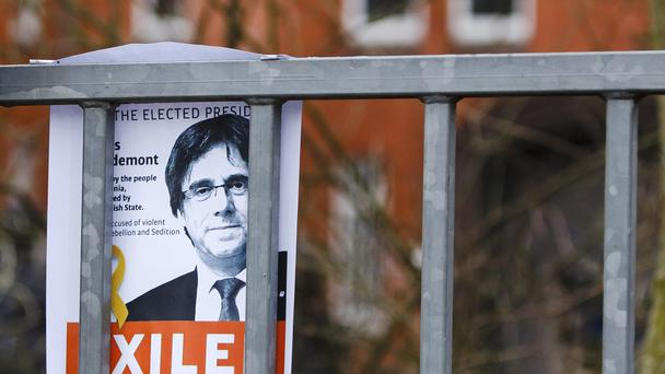 A picture of Carles Puidgemont is fixed in front of a prison in Neumuenster, northern Germany (Frank Molter/dpa/AP)