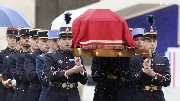 French Republican Guards and cadets from the joint-army military school carry the coffin of Arnaud Beltrame during a national ceremony in Paris (Ludovic Marin, Pool via AP)