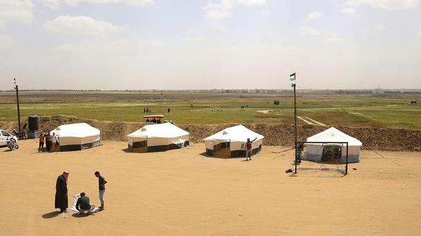 Youths prepare their tents ahead of mass demonstrations along the Gaza Strip border with Israel (Adel Hana/AP)