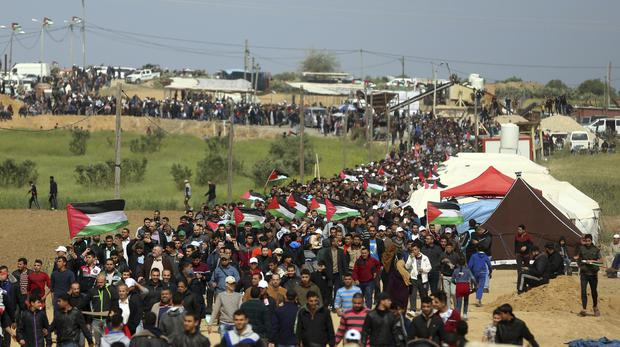 Palestinians attend a demonstration near the Gaza Strip border with Israel (Khalil Hamra/AP)