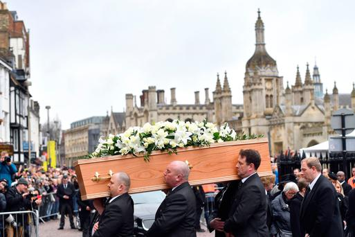 Mourners: The casket containing Professor Stephen Hawking is carried into the church in Cambridge. Photo: Joe Giddens/PA