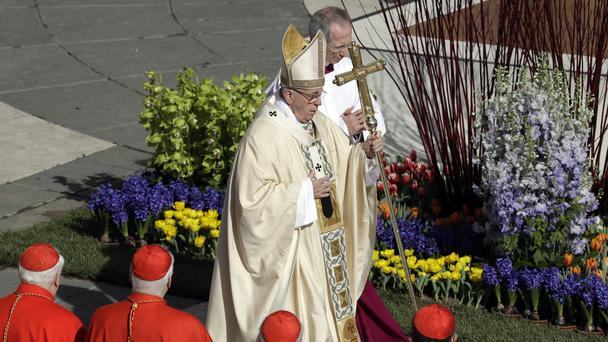 Pope Francis walks with the pastoral staff as he arrives to celebrates the Easter mass in St Peter's Square at the Vatican (Gregorio Borgia/AP)