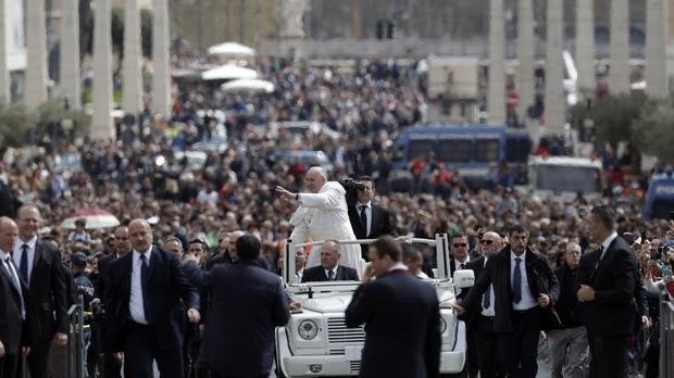 Pope Francis tours St Peter's Square at the Vatican after celebrating an Easter mass (Andrew Medichini/AP)