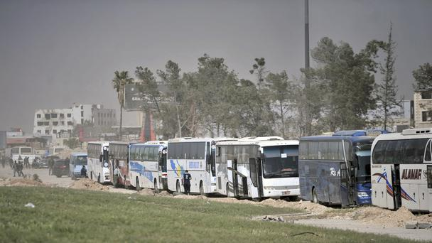 Picture taken on March 27 of buses to take rebels out of Ghouta (AP)