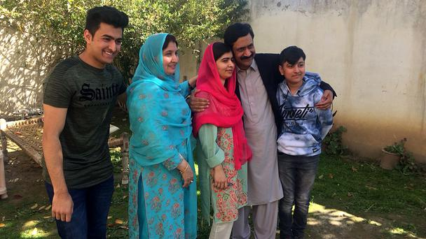 Malala Yousafzai with her family at her native home in Mingora (Abdullah Sherin/AP)