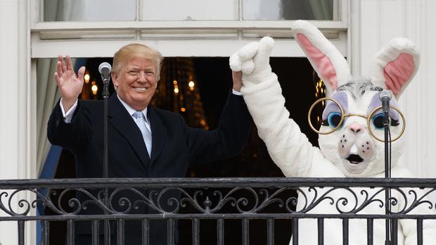 President Donald Trump holds hands with the Easter Bunny (Carolyn Kaster/AP)