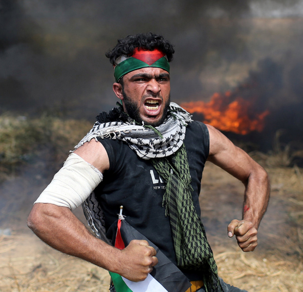 Palestinian protester reacts during clashes with Israeli troops at the Israel-Gaza border. Photo: Reuters