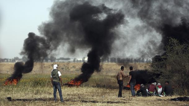 Palestinians streaming toward Gaza border protest camps