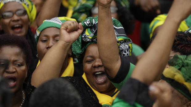 Women of the African National Congress gather outside the family home of the late Winnie Madikizela-Mandela (Themba Hadebe/AP)