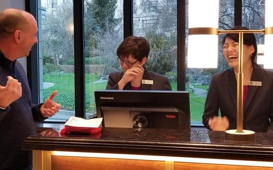 Mr Burchill speaking with staff at the hotell Credit: Facebook