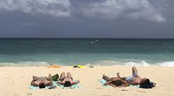 Tourists on the beach on Boracay island (Aaron Favila/AP)