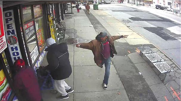Surveillance video image shows Saheed Vassell brandishing a metal object (New York Police Department via AP)