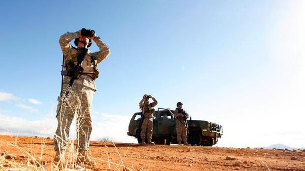 Arizona and Texas are preparing to deploy National Guard members to the US-Mexico border (Ross D Franklin/AP)