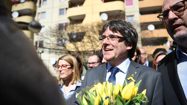 Former Catalan leader Carles Puigdemont leaves a news conference in Berlin (Britta Pedersen/dpa via AP)