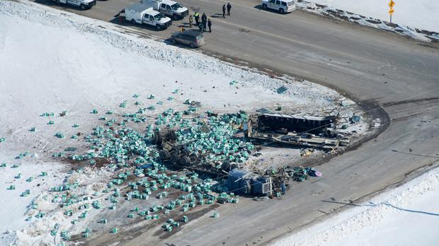 Emergency personnel at the scene of the crash (Jonathan Hayward/The Canadian Press via AP)