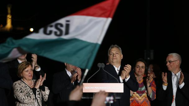 Viktor Orban greets his supporters in Budapest (Darko Vojinovic/AP)