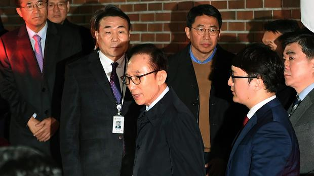 Former South Korean president Lee Myung-bak, centre is transferred to a detention centre (Jung Yeon-je/Pool via AP)