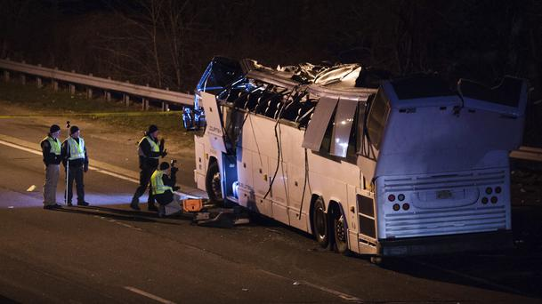 A bus that was carrying teenage passengers is inspected in Lakeview, New York (Kevin Hagen/AP)