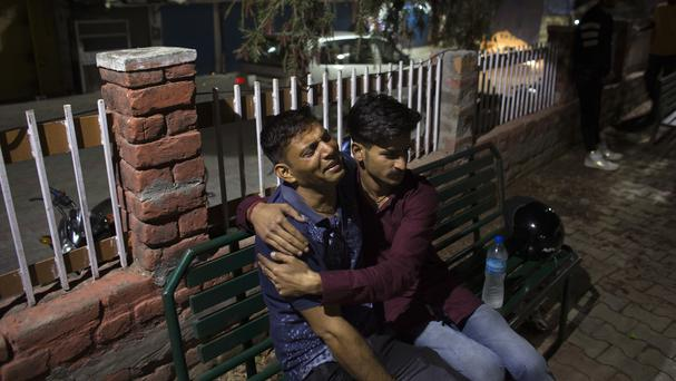 A father grieves the death of his son outside a government hospital in Nurpur (Ashwini Bhatia/AP/PA)