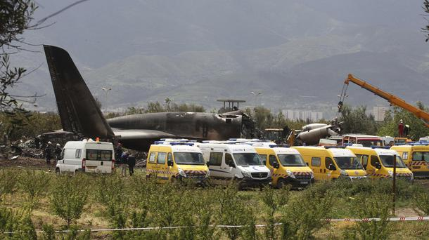 Firefighters and civil security officers at the scene of the fatal crash in Boufarik (Anis Belghoul/AP)