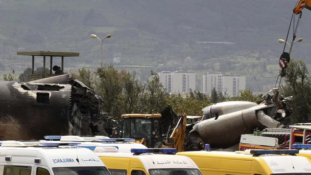 Ambulances near the Algerian military plane after it crashed in Boufarik (Anis Belghoul/AP)