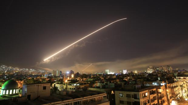 The Damascus sky lights up missile fire as the U.S. launches an attack on Syria (Hassan Ammar/AP)