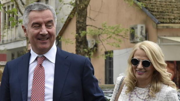 Presidential candidate Milo Djukanovic and his wife Lidija after voting in Podgorica (AP Photo/Risto Bozovic)