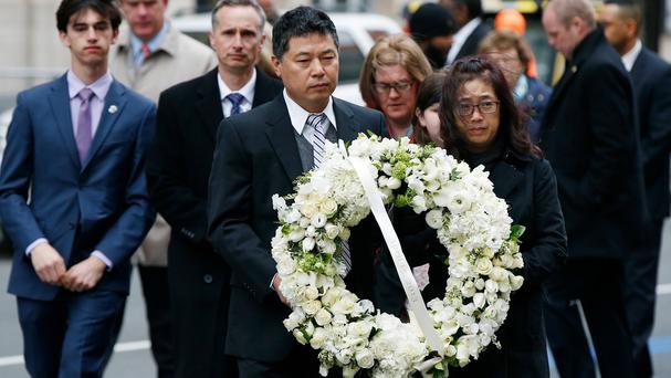Wreaths are laid to honour the dead after the Boston Marathon attack five years ago (Michael Dwyer/AP)