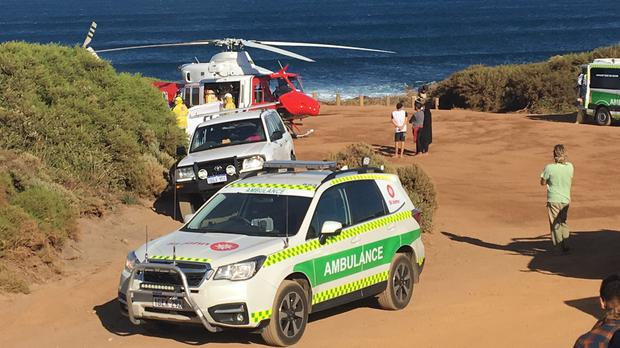 A rescue helicopter and other emergency vehicles are seen at the scene of the shark attack in Gracetown, Australia (ABC/AP)