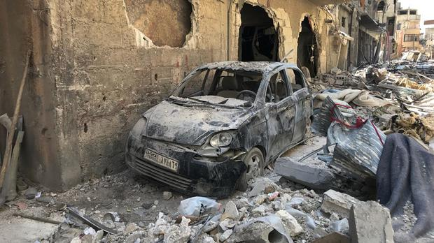 Rubble lines a street in Douma, the site of a suspected chemical weapons attack (AP)
