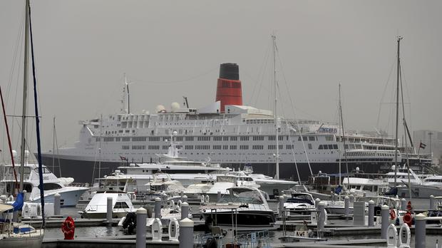 The Queen Elizabeth 2 is moored off the Mideast city-state of Dubai (Kamran Jebreili/AP)