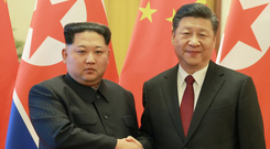 North Korean leader Kim Jong-un shakes hands with Chinese President Xi Jinping during unofficial visit to Beijing last month