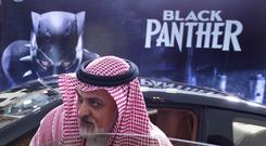 Scenes at an invitation-only screening of Black Panther at the King Abdullah Financial District Theatre in Riyadh (AP Photo/Amr Nabil)