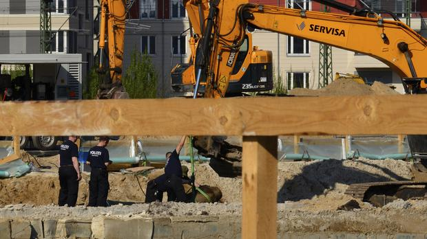 Experts prepare a Second World War bomb for removal in Berlin (dpa/AP)