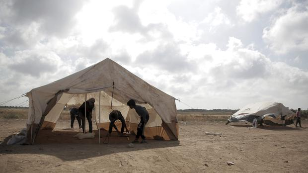Palestinian protesters set up tents at the Gaza Strip's border with Israel (AP)