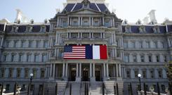 The US and French flags are displayed on the Eisenhower Executive Office Building in Washington (Alex Brandon/AP)
