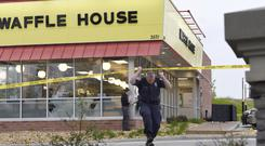 Officials work the scene of a fatal shooting at a Waffle House (George Walker IV/The Tennessean via AP)