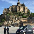 Police attend the scene of an evacuation at Mont Saint-Michel, on France's northern coast (Denis Surfys/AP)