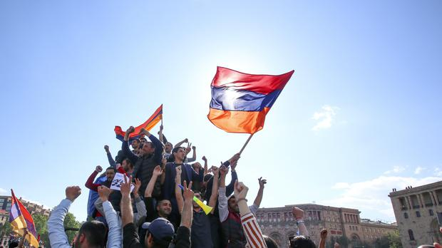 People celebrate Armenian Prime Minister's Serzh Sargsyan's resignation in Republic Square in Yerevan (AP)
