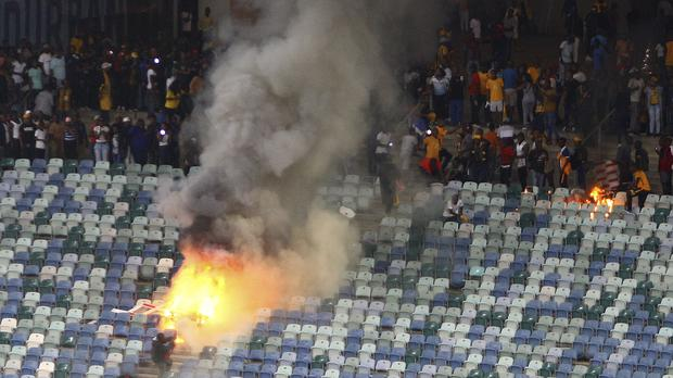 A fire burns in the stands at the stadium in Durban
