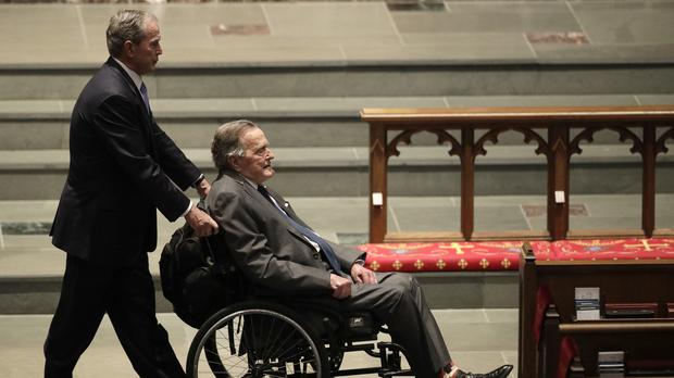 George W Bush and George H W Bush at the funeral service for former first lady Barbara Bush, (David J Phillip/AP)