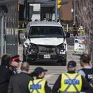 Police on the scene after a van mounted the pavement crashing into pedestrians in Toronto (Aaron Vincent Elkaim/The Canadian Press via AP)